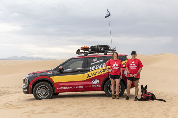 """Representing the veterans charity, Record the Journey, driving a 2022 Mitsubishi Outlander in the 2021 Rebelle Rally, is (from left) Erin Mason, Selena """"Mason"""" Converse and Sammy, a PTSD-trained service dog"""